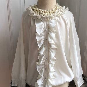 Joie ruffle blouse (necklace not included).